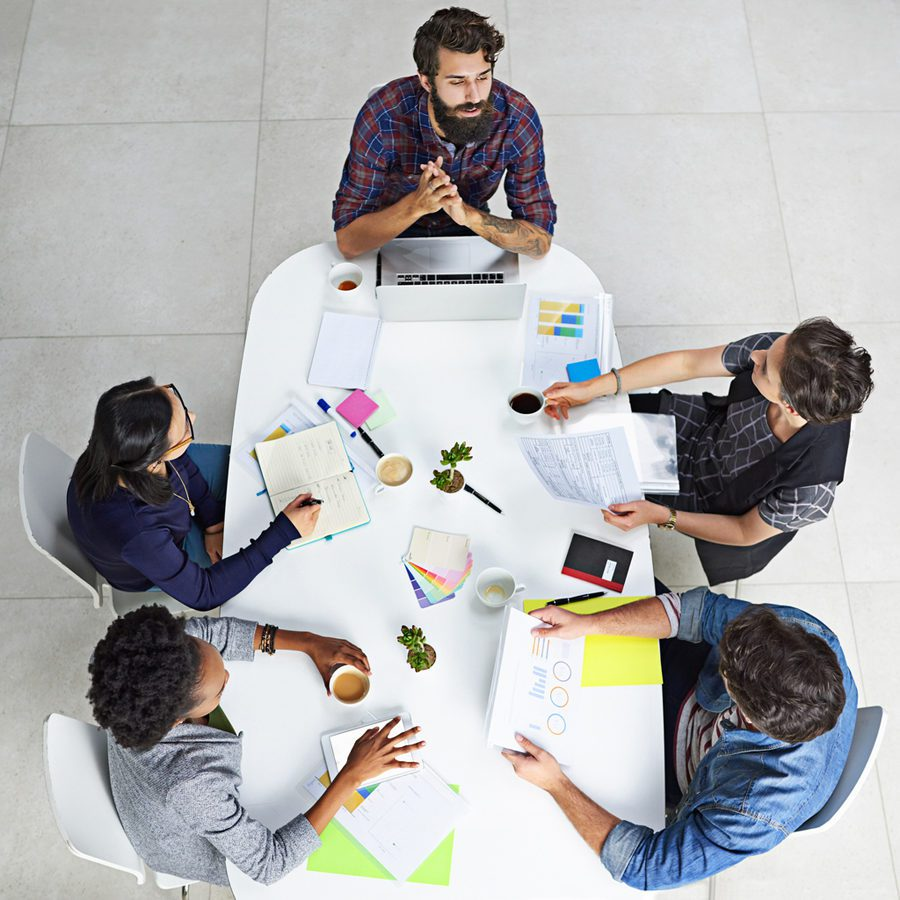 High angle shot of coworkers having a meeting in a modern office